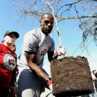 LeBron helps plant a tree during the 2013 NBA Cares Day of Service at the LIVE Project in Houston.