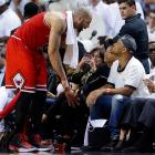 Carlos Boozer talks with Will and Jaden Smith during the second half of Game 5 of the Eastern Conference semifinals between the Bulls and Heat in Miami.