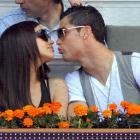 Cristiano Ronaldo leans in to kiss Irina Shayk as they attend the Mutua Madrid Open tennis tournament at La Caja Magica.