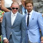 Rooney and Gerard Butler attend the Gentlemen's Singles Final match between Andy Murray of Great Britain and Novak Djokovic of Serbia on day thirteen of the Wimbledon Lawn Tennis Championships at the All England Lawn Tennis and Croquet Club on July 7, 2013 in London.