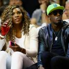 Bolt sits alongside Serena Williams during Game Four of the 2014 NBA Finals between the Heat and Spurs at American Airlines Arena in Miami.