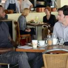 """Lebron looks to be filming his role in the upcoming comedy """"Trainwreck"""" with Bill Hader at a restaurant in New York City during the summer of 2014."""
