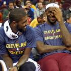 Kyrie Irving and LeBron James share a laugh on the bench during the Cavs preseason exhibition game with Maccabi Electra Tel Aviv in Cleveland.