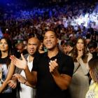 Will Smith cheers for the start of the Floyd Mayweather vs. Marcos Maidana WBA and WBC welterweight title fight in Las Vegas.
