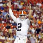 Johnny Manziel celebrates his first touchdown of the NFL preseason, an 8-yard pass to Dion Lewis in the fourth quarter against the Washington Redskins on Aug. 18, 2014 at FedEx Field in Landover, Md.