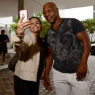 Mike Tyson stops to take a selfie with a fan.