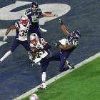 On the Seattle Seahawks' bizarre final play, New England Patriots Malcolm Butler cornerback stepped in front of wide receiver Ricardo Lockette to take the ball, and the game, away. The Pats won 28-24.