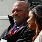 Jim Brown and his wife Monique watch the pregame workouts before the New York Jets game against the Cleveland Browns at MetLife Stadium in 2015.