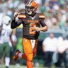 Johnny Manziel celebrates his first regular season NFL touchdown pass, a 54-yard completion to Travis Benjamin, on just his second throw of the day after replacing starting quarterback Josh McCown, who went down with a concussion on the Cleveland Browns opening drive against the New York Jets on Sept. 13, 2015 at MetLife Stadium in East Rutherford, N.J. Manziel had three subsequent turnovers and finished 13-for-24 with 182 yards in the 31-10 loss.