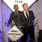 Will Smith and Boomer Esiason speak on stage during the Sports Illustrated Sportsperson of the Year Ceremony 2015 at Pier 60 in New York City.