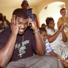 Tennessee defensive tackle John Henderson talks on a cell phone during a family celebration after he was selected No. 9 by the Jacksonville Jaguars in 2002.