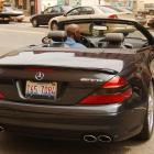 Michael Jordan leaving the MCI Center in Washington in a black convertible. This photo was taken right after MJ met with Wizards owner Abe Pollin, who fired him from the organization.