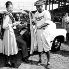 """Jackie Robinson is handed the keys to this car by tap dancer Bill Bojangles Robinson in 1947.  The car was an award presented to Robinson by fans on """"Jackie Robinson Day"""" at Ebbets Field."""