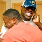 Indiana defensive end Victor Adeyanju is given a celebratory hug by his brother after hearing that he was drafted in the fourth round by the St. Louis Rams in the 2006 draft.