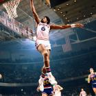 January 1977 | Philadelphia 76ers forward Julius Erving gets full extension on a one-handed dunk against the Denver Nuggets.