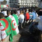 Algerian fans gather outside of the central post office building in Algiers to watch the match between Algeria and Belgium.