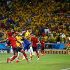 Goalkeeper Guillermo Ochoa of Mexico saves header attempt by Thiago Silva of Brazil during the Group A match.