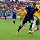 Robin Van Persie of the Netherlands and Matthew Spiranovic of Australia battle for the ball during a 3-2 win by the Netherlands.