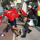 Security personnel attempt to control Chilean fans at Maracana Stadium prior to the kickoff of the 2014 FIFA World Cup Brazil Group B match between Spain and Chile.