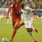 Belgium midfielder Marouane Fellaini and U.S. defender DaMarcus Beasley jockey for position as they chase after the ball.