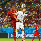 United States' Fabian Johnson and Belgium's Daniel Van Buyten go up for a header.