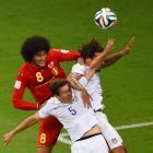 American teammates Matt Besler and Jermaine Jones challenge Belgium midfielder Marouane Fellaini in the first half.