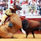 A picador and his horse are hit by a bull during the Dax corrida, part of the 'Fetes de Dax' traditionnal feria on Aug. 15.