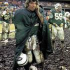 Bills at Jets, Dec. 8, 1974 | New York Jets quarterback Joe Namath listens on the sidelines during a messy New York Jets-Buffalo Bills Game. The Jets would win 20-10 behind Namath's 131 yards and two passing touchdowns.