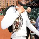 """All smiles for the champion as Johnny """"Bones"""" Jones tours Camden Yards, home of the Baltimore Orioles, before his UFC 172 battle with Glover Teixeira."""