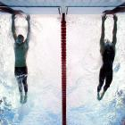 Beijing Olympics, Aug. 16, 2008 | American swimmer Michael Phelps out-touches Serbian swimmer Milorad Cavic by 0.01 seconds at the finish of the 100-meter butterfly final. It was the seventh of Phelps' record eight golds during the Olympics.