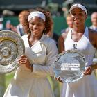 Serena Williams victorious in 2009 with Rosewater Dish trophy after winning the Finals match against Venus at All England Club.