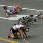More bloodletting in the final meters. While Robbie (the Pocket Rocket) McEwen won the sprint ahead of them, Kurt-Asle Arvesen (bottom) and Jimmy Casper of France hit the deck hard in Stage 2 of the '04 tour.  Both riders remounted and finished that Tour – Casper dead last, in 147th place. But he finished.