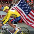 The 2000 Tour de France winner Lance Armstrong is supported by spectators during his victory lap on the Champs-Elysees after the last stage of the 87th French cycling race in July 2000.