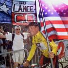 The winner of the 1999 Tour de France American Lance Armstrong is supported by spectators during his victory lap on the Champs-Elysees in Paris in July 1999.