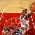 Michael Jordan skies for a dunk over Lakers center Vlade Divac in Game 2, a 107-86 Chicago win. Jordan scored 33 points on 15-of-18 shooting, including his famous hand-switching layup to lead the Bulls.