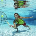 Seventeen-year old rising tennis star Tatiana Golovin of France hits a shot underwater in 2005.