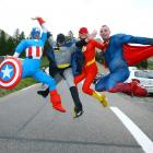 Fans dressed up as Captain America, Batman, Flash and Superman are pictured in the Col d'Izoard as they wait for the riders during stage 14 of the 2014 Tour of France.