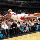 Pacers at Bulls, March 7, 1997 | Chicago Bulls power forward Dennis Rodman goes horizontal for a loose ball during a game against the Pacers at the United Center in Chicago, Ill. Rodman won his sixth rebounding title during the 1996-97 season averaging 16.1 total rebounds a game.