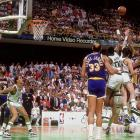 Magic Johnson drains his famous junior sky hook over Robert Parish and Kevin McHale to win Game 4 for the Lakers at the buzzer. Johnson was named Finals MVP.