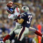 Super Bowl XLII, Feb. 3, 2008 | New York Giants receiver David Tyree (left) secures a catch with his helmet as Rodney Harrison (right) tries to wrestle him to the ground. Tyree's catch was instrumental in the New York Giants' upset of the previously undefeated Patriots, 17-14.
