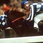 Belmont Stakes, June 9, 1973 | Ron Turcotte, riding Secretariat, takes a quick peek over his shoulder at his competitors during the running of the 1973 Belmont Stakes. Secretariat would go on to win the race in 2:24 by 31 lengths, the fastest time and largest margin of victory in the history of the race. With the win, Secretariat became the ninth Triple Crown winner in history, and the first winner in 25 years.