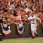 Angels at Orioles, Sept. 6, 1996 | Baltimore Orioles fans congratulate shortstop Cal Ripken, Jr. shortly after he breaks Lou Gehrig's consecutive games played record. Ripken would end his own streak at 2,632 games in 1998, surpassing Gehrig's record by 502 games.