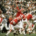 Kansas City Chiefs quarterback Len Dawson throws a pass against the Minnesota Vikings in the last meeting of AFL and NFL champions before the two leagues merged after the season. Dawson earned Super Bowl MVP honors after completing 12 of 17 passes for 142 yards and a touchdown in Kansas City's 23-7 victory.