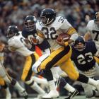 Pittsburgh Steelers fullback Franco Harris sprints away from the Minnesota Vikings defense on a carry. Harris set a Super Bowl record with 158 rushing yards as he earned Super Bowl MVP honors in the Steelers' 16-6 victory.