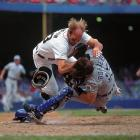 Royals at Tigers, Aug. 9, 1995 | Kirk Gibson collides with Royals catcher Pat Borders.