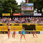 April Ross spikes over Traci Weamer in the quarter finals won by Ross/Walsh Jennings 21-18 and 21-16.