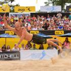Champ Casey Patterson goes airborne for one of his 35 digs this one when he and Jake Gibb needed to rally in the finals.