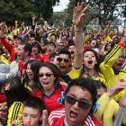 Colombia soccer fans in Bogota cheer during their team's 3-0 win over Greece on Saturday, June 14.