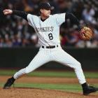 Colorado's Brent Mayne held the Braves scoreless for an inning, enabling the Rockies to take the win in the bottom of the 12th. Mayne, who had never pitched at any level, was the first positional player to be credited with a win in 32 years.