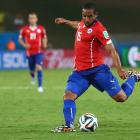 Jean Beausejour of Chile shoots and scores his team's third goal against Australia at Arena Pantanal on June 13.